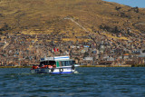 Tourist boat sailing back to Puno