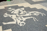 Dancing figures on the pavement, Calle Lima, Puno