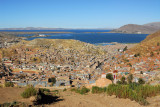 Nice view of Puno and Lake Titicaca with snow covered Bolivian peaks in the distance