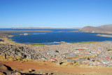 Puno and Lake Titicaca with snow covered Bolivian peaks in the distance