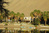 The Laguna of Huacachina is surrounded by hotels, guesthouses, bars and restaurants