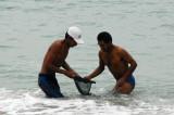 Fisherman braving very cold water