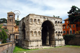 Arch of Janus-4th C. AD, a quadrifrons triumphal arch southwest of the Forum with the 12th C belltower of San Giorgio al Velabro
