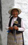Tibetan woman with a prayer wheel