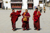 Monks headed for the monastery gate after noon prayers