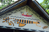 Painted storyboard of one of the thatched pavilions at Jungle River Boat Cruises bai