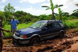 Stuck in the mud on the road to Melekeok  within 1/2 mile of the new Palau Capitol building