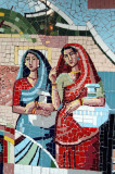 Mosaic of two women in traditional Bengali clothes carrying jugs