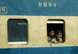 Friendly Bangladeshis looking out the window of a train, Dhaka