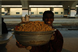 Vendor selling peanunts on the platform of Kamalapur Railway Station, Dhaka