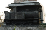 The monument encorporates a small steam locomotive