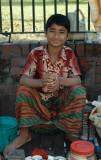 Young sidewalk salesman, Dhaka
