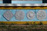 Old Bangladeshi coins on the base of the roundabout monument Doyel Chattar, Dhaka