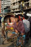 Rickshaw in front of the National Book Center, S.S. Nazrul Islam Sharani, Dhaka
