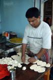 Man rolling some kind of dumpling, Station Road