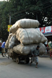 A very small man pulling a very big load, Dhaka