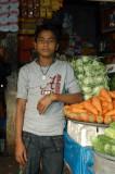 Boy working at a small shop near Motijheel AGB Colony