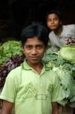 Boy in green matching the produce, Dhaka