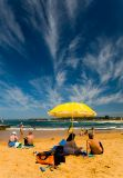 Umbrella at Narrabeen Beach with great sky