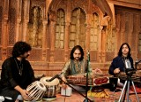 Pandit (center) playing his santoor at the Crow.jpg
