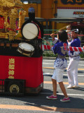 Taiko player behind a kagura float