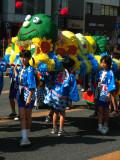 Children carrying a caterpillar palanquin