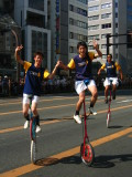 A friendly group of unicyclists