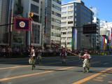 Carrying a banner down Ōtsu-dōri