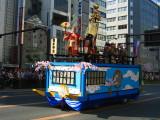 Toyotomi Hideyoshi atop a parade car
