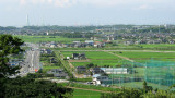 Rice fields and distant Chita industry