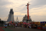 Festival yatai at sunset against the ASPAM Building