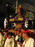 Carrying a festival float in the parade