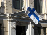 Finnish flag hanging off a neo-classical building