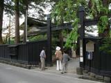 Tourists peeking inside a buke-yashiki courtyard