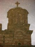 Dome of Sveti Marko reflected in rain puddle