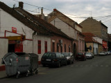 Curbside-parked cars and old houses, Zemun