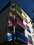 Colorful balconies on a modern housing block