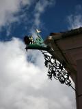 Metal dragon ornament jutting off a building