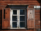 Window and shutters on an old wooden house
