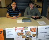 Yoann Buch (L) and another student selling ISU International Night tickets IMG_0558.jpg