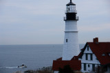 DSC00660.jpg TINY BOAT HEADS OUT FOR LOBSTER PAST THE GRAND LADY  portland head light maine