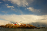 100DSC03437.jpg 'SNOW SQUALL AND DISTANT WATER SPOUT AT NUBBLE LIGHTHOUSE... lighter than adj one