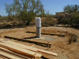 Two of the eventual 5 beams were supported by pre-cast concrete piers sunk in the ground to prevent skidding.