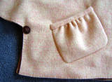 Side Button Closure and Pocket