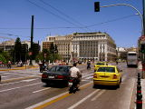 A road scene outside the Parliament Building and Syntagma Square