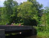 Bike Riders On The Bridge II