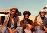 Three Mujahideen sitting in the sun