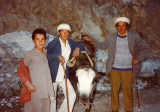 Three people and a yak