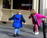 child duet dancing to Rue Cler musicians