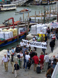 ubiquitous Venetian demonstrators pass workers unloading towels for delivery...